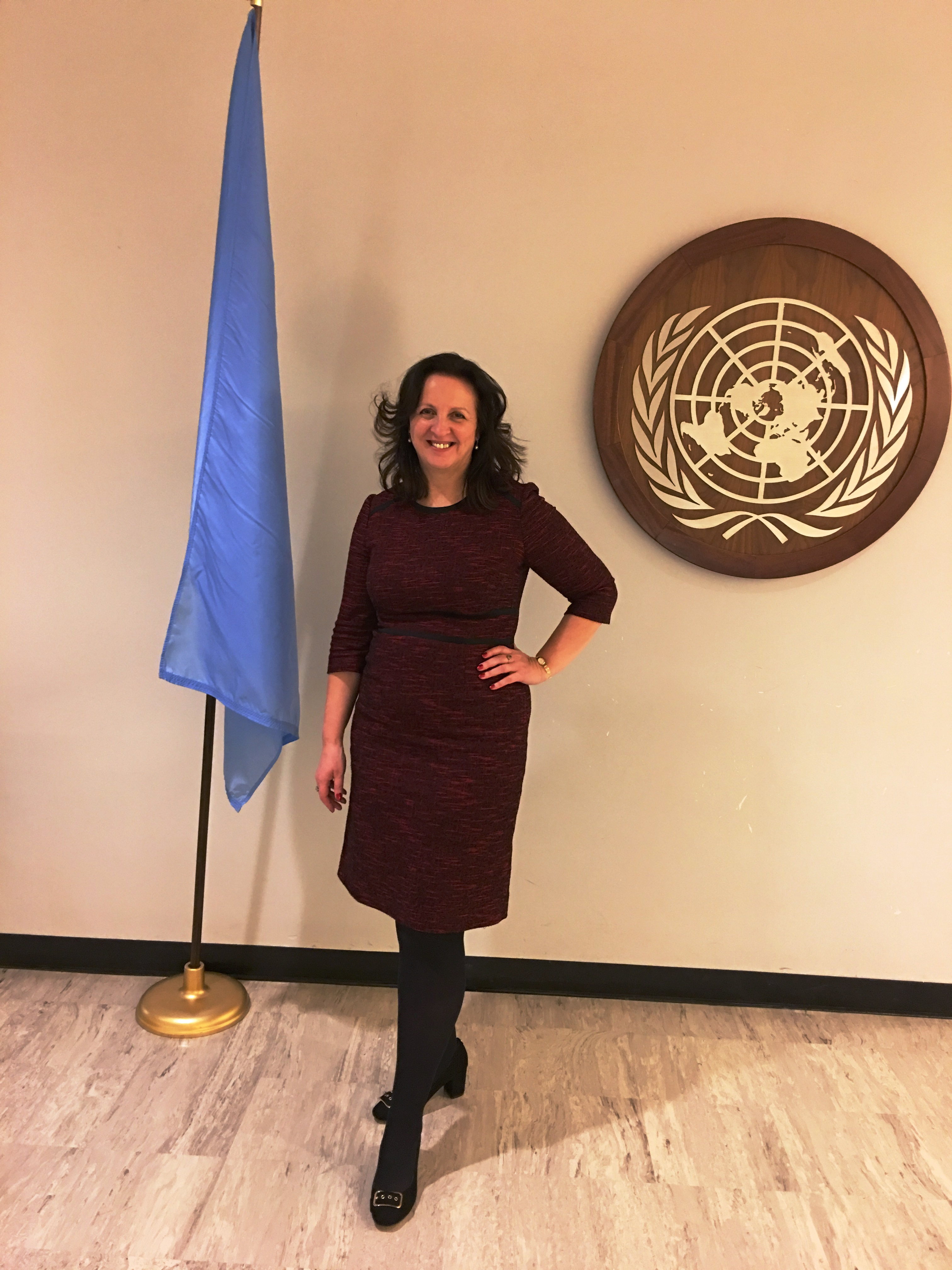 image Jacqueline Winstanley in front of the UN flag